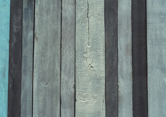 Grey, black ,and blue wood texture background. Wood backdrop. Rough surface texture of wooden panel. Vintage and retro background. Unique wood abstract background. Wooden wallpaper with unique pattern