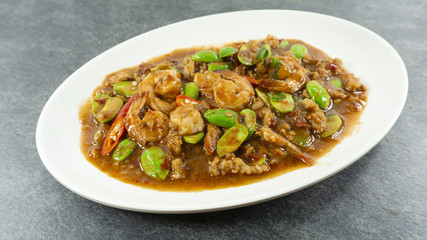 Thai food. Stir Fried Sator beans with Shrimp on stone background. Top view, Copy space for design. .