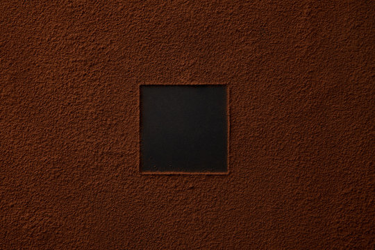 top view of gourmet cocoa powder with square copy space on black background