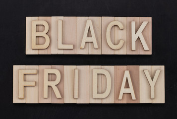 black Friday - text in wooden letters on blackBoard. Copy space