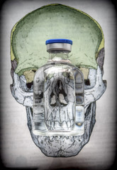 Vials on a skull, conceptual image of life and death