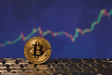 Bitcoin with stock exchange chart background