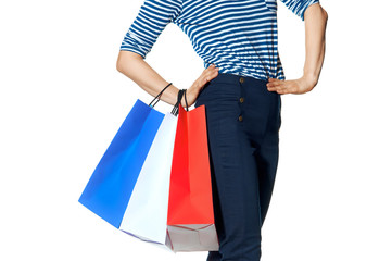 modern woman with shopping bags on white background
