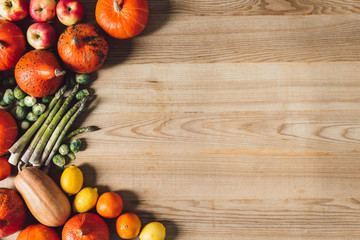 top view of arranged fresh autumn vegetables and fruits on wooden surface