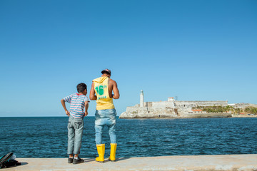 Brothers fishing at Malecon of Havana