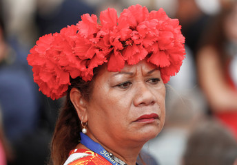 A faithful from Tahiti wears her hat at the Vatican