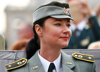 A police officer from Slovakia wears her hat at the Vatican