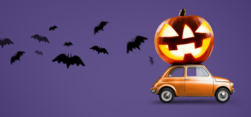 Halloween car delivering pumpkin against night scary autumn forest background