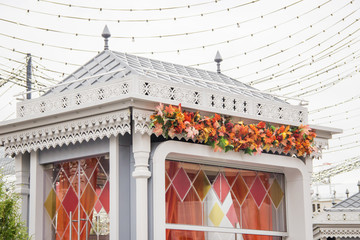 A gift shop with traditional russian ornament and stained glass decorated with maple leaves for an autumn fair