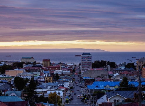 View over city towards Strait of Magellan at sunrise, Punta Arenas, Magallanes Province, Patagonia, Chile