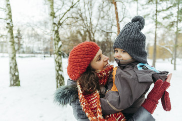 Mother and little son in the snow