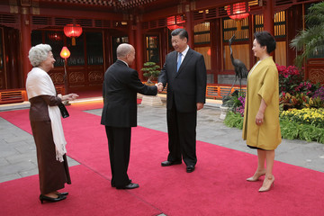 China's President Xi Jinping and his wife Peng Liyuan welcome Cambodia's King Norodom Sihamoni and his mother, former queen Monique at Diaoyutai State Guesthouse