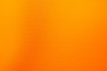 orange background with different texture waves the interference of light, dark and bright areas