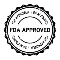 Grunge black FDA approved word round rubber seal stamp on white background