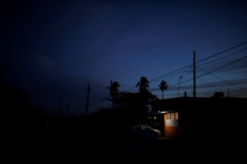 A house is seen in an area without street lighting after the electrical grid was damaged by Hurricane Maria last year, in Loiza