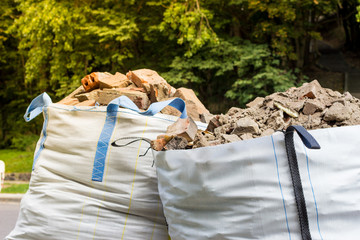 Two big bags container with rubble.