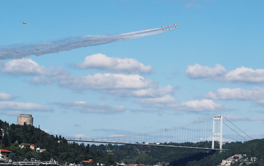 Turkish Stars, the aerobatic team of the Turkish Air Force, fly their Northrop F-5 Freedom Fighters over Bosphorus in Istanbul