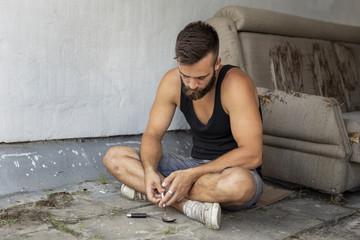 Filling up a heroin syringe