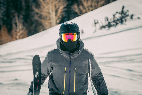 Masked Skier On The Side Of A Resort Mountain