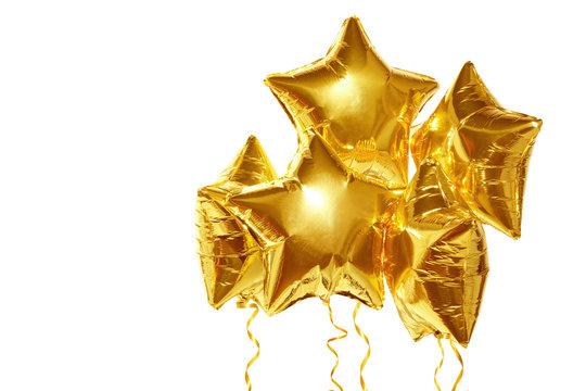 festive golden stars balls on white background