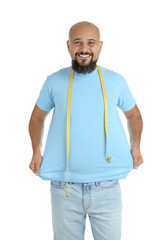 Overweight man with measuring tape on white background