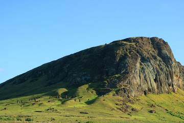 Rano Raraku volcano with the abandoned Moai statues scattered on the slope, Easter Island of Chile, South America