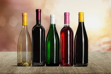 Wine bottles in row isolated on white background
