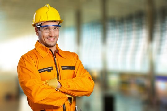 Young man in work uniform and yellow