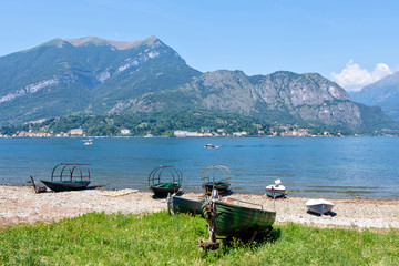 Old boats parked on shore of Lake Como