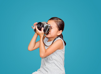 Beautiful smiling girl holding a camera.