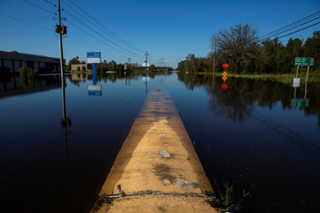 A road is blocked by flood waters in the aftermath of Hurricane Florence, now downgraded to a tropical depression, in Kinston