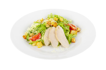 Caesar salad with slices of chicken breast, rusks, cherry tomato, lettuce, cheese on plate, white isolated background Side view. For the menu, restaurant, bar, cafe