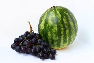 Watermelon and grapes on a white background