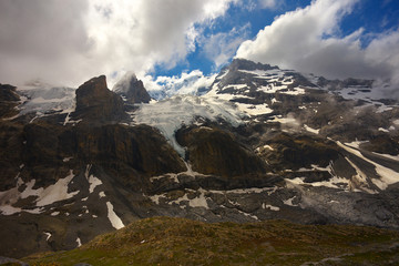Mountains with glacier and peaks of Blüemlisalp and Ufem Stock nearby resort of Kandersteg, Switzerland