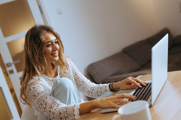 woman using laptop in her home