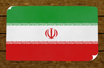 Illustration of an Iranian flag on the papier pasted on the woody wall