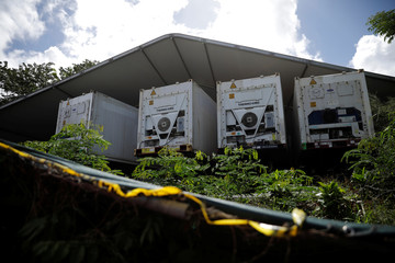 Refrigerated containers are seen at the Institute of Forensic Sciences in San Juan