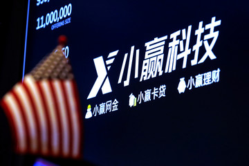 A screen displays information for X Financial, a Chinese technology personal finance company, during the company's IPO at the NYSE in New York