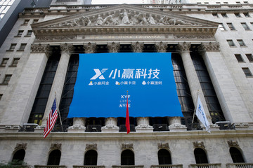 A banner for X Financial, a Chinese technology personal finance company, is displayed to celebrate the company's IPO at the NYSE in New York