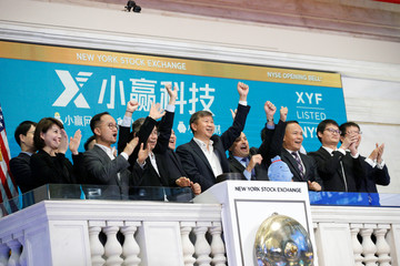 Shaoyong (Simon) Cheng, president of X Financial, a Chinese technology and personal finance company, rings the opening bell with members of the company's leadership team to celebrate the company's IPO at the NYSE in New York