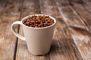 A cup filled with coffee beans