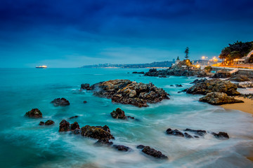 Beautiful view of Pacific rocky coast in Vina del Mar of waves hitting the rocks in Chile