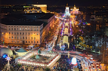 KYIV (KIEV), Ukraine-JANUARY 08, 2018: Main Kyiv's New Year tree and Christmas market on St. Sophia Square. Open air cafes, children's attractions and souvenir kiosks