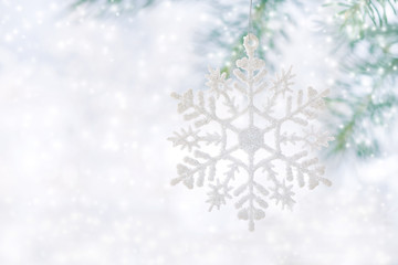Christmas background, snowflake on a beautiful white background with snow.