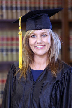 Attractive middle aged woman graduate, portrait of a law school graduate,  woman attorney