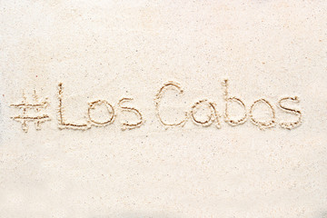 """Handwriting words """"Los cabos"""" on sand"""