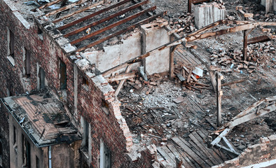 Color toned picture of a destroyed building, disaster concept.