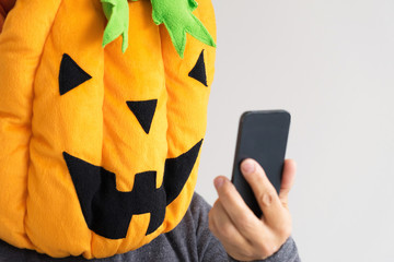 close up of a person in the Halloween pumpkin costume taking a selfie
