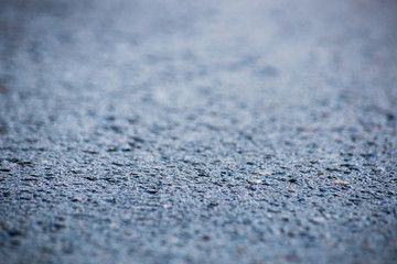 Abstract blue background with asphalt, soft focus