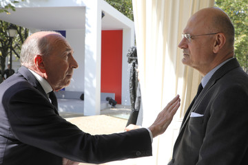 French Interior Minister Gerard Collomb speaks with National Coordinator of Intelligence Pierre de Bousquet de Florian during the national ceremony to pay tribute to the victims of militant attacks, in Paris